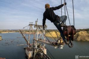 Urban explorer climbing on crane