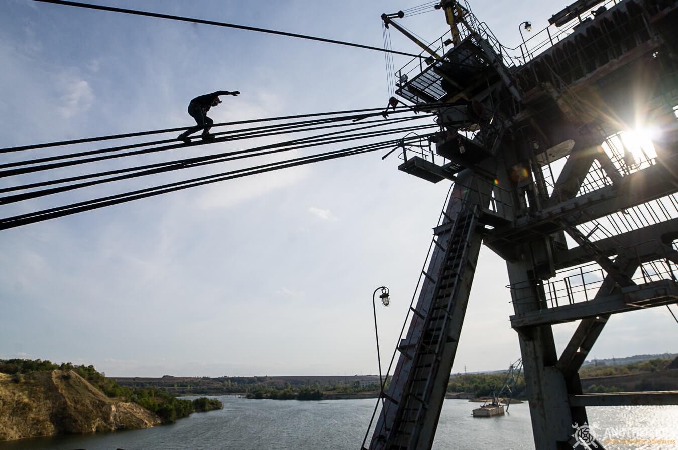climbing on abandoned mining machine