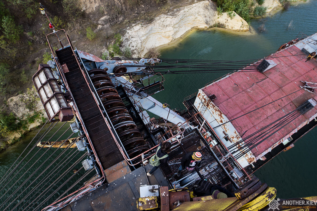 view from the top of flooded abandoned open mining digger
