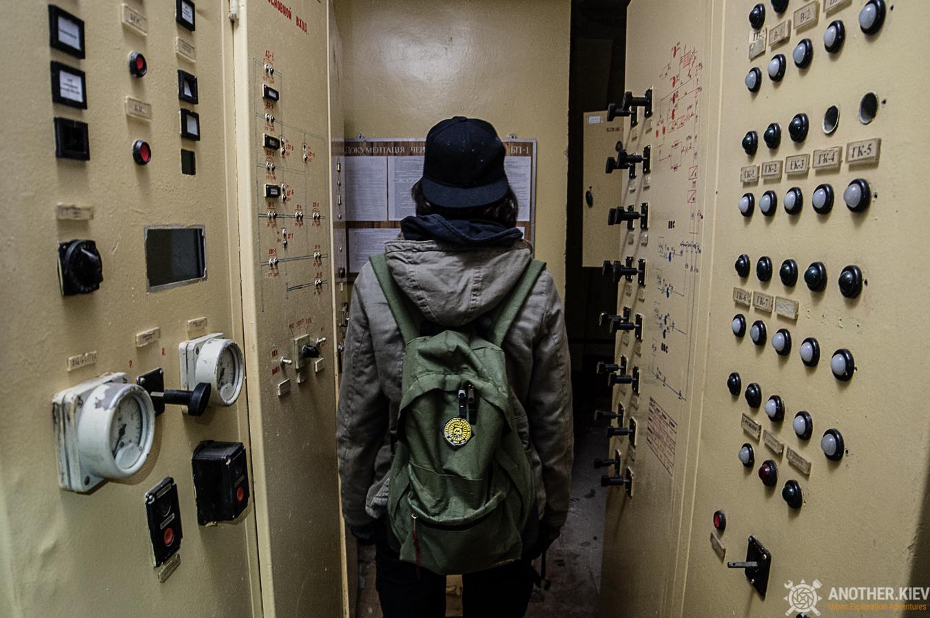 urban explorer inside abandoned bunker