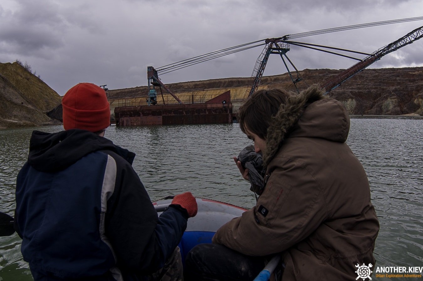 we float on an inflatable boat to a submerged excavator