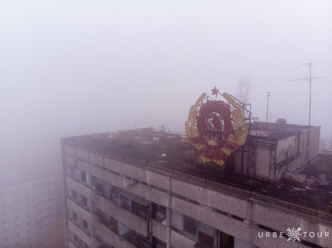 soviet coat of arms on the top of building in Prypiat