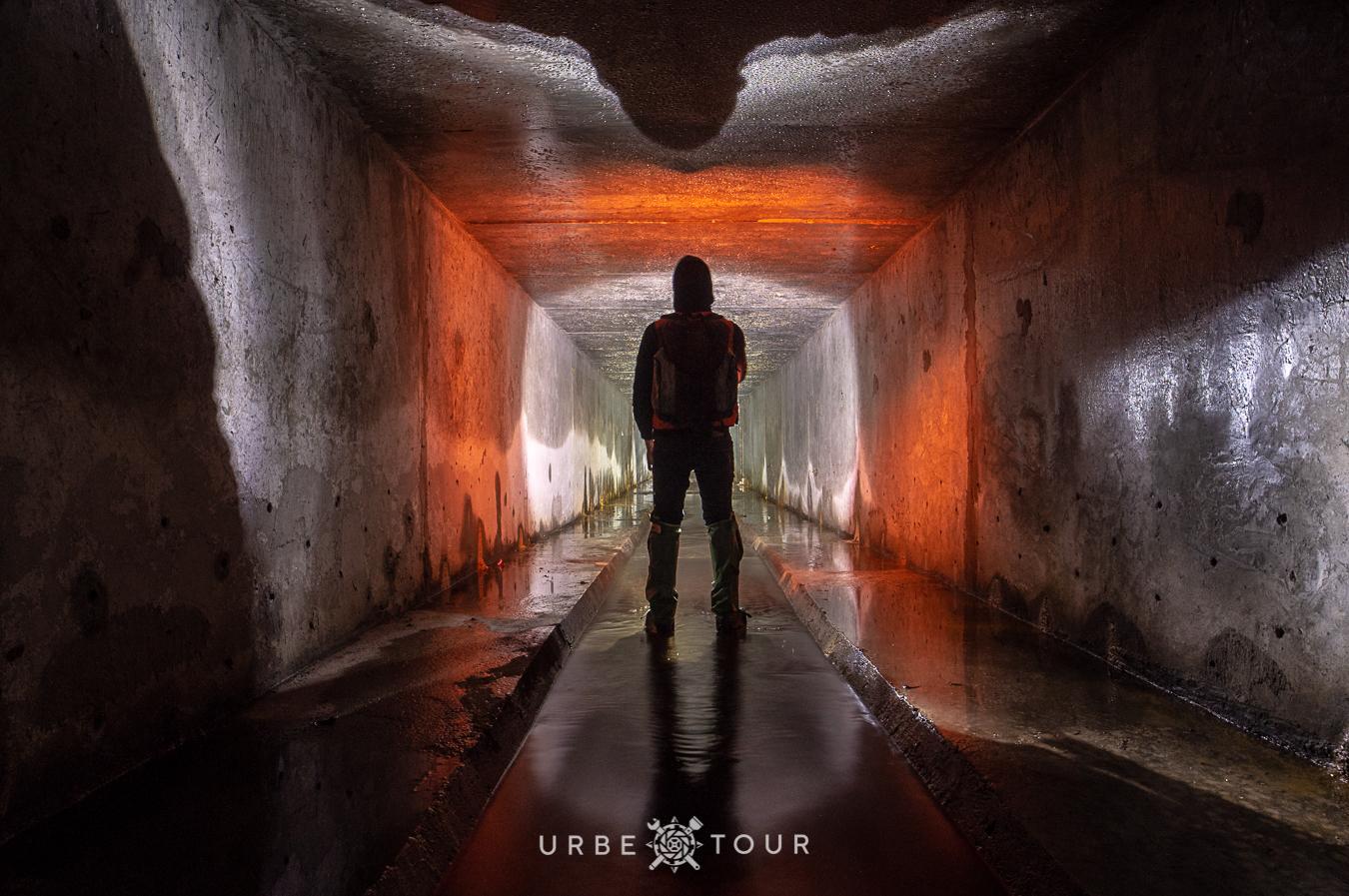 explorer in underground river