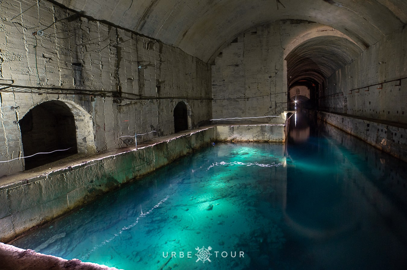 aqua blue water inside abandoned albanian submarine base